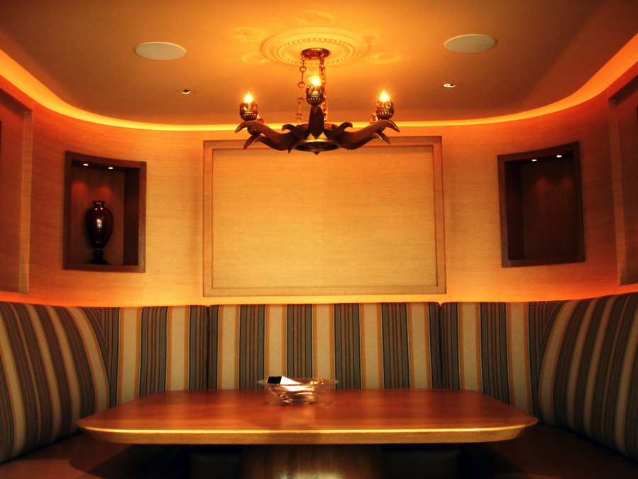... Riverhouse Residence - Dining Room featuring Iluminated Display Niches,  Perimeter Cove Lighting, and custom